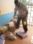 Nurse Nicholas dividing up the food for the poorest families right before Christmas