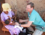 Dr Tomedi immunizing a child